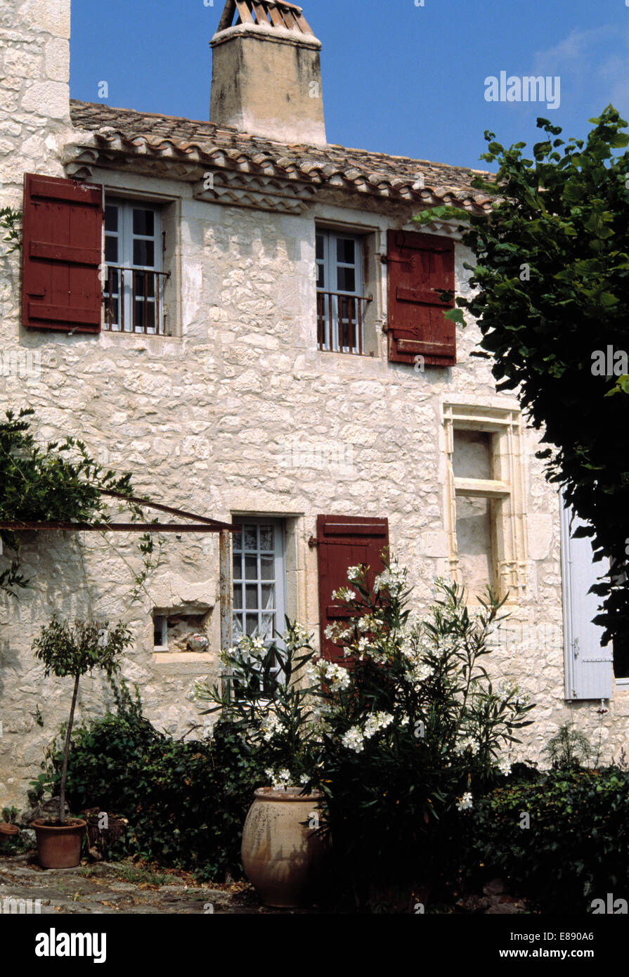 Wooden Shutters On Stone Built French Country Cottage Stock