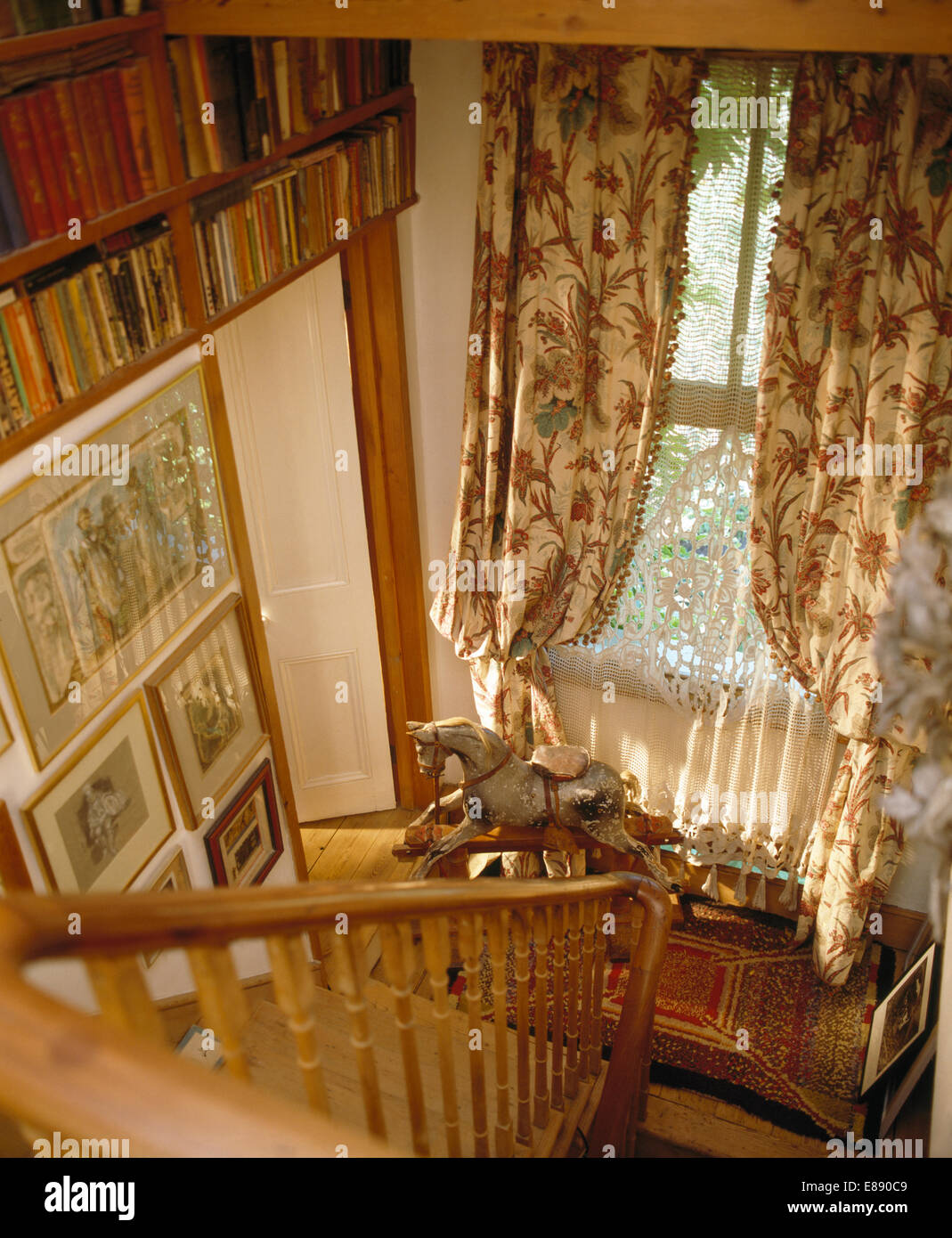 Looking Down Staircase To Floral Curtains On Window Above Rocking