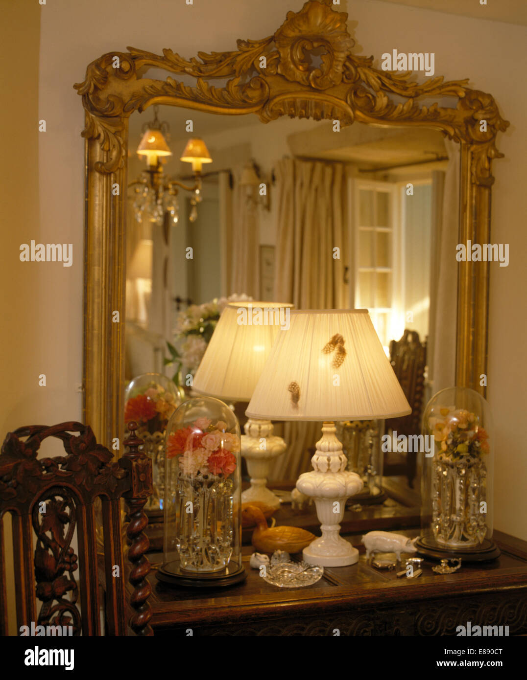 Close Up Of Large Ornate Antique Mirror Above Shelf With Lighted