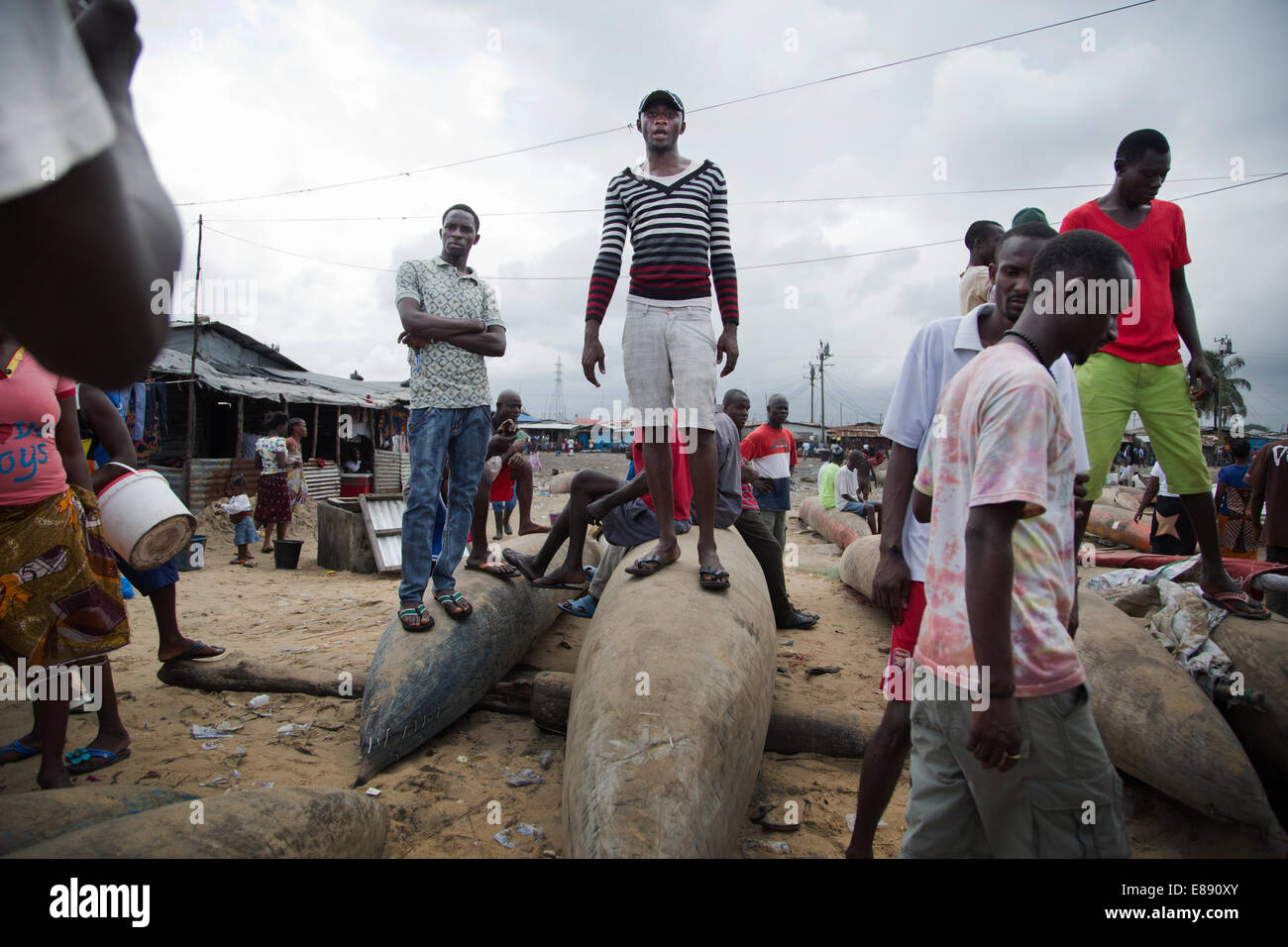 Fisherman in the Monrovian township of West Point in Liberia. Fisherman in West Point are suspected of bringing - Stock Image