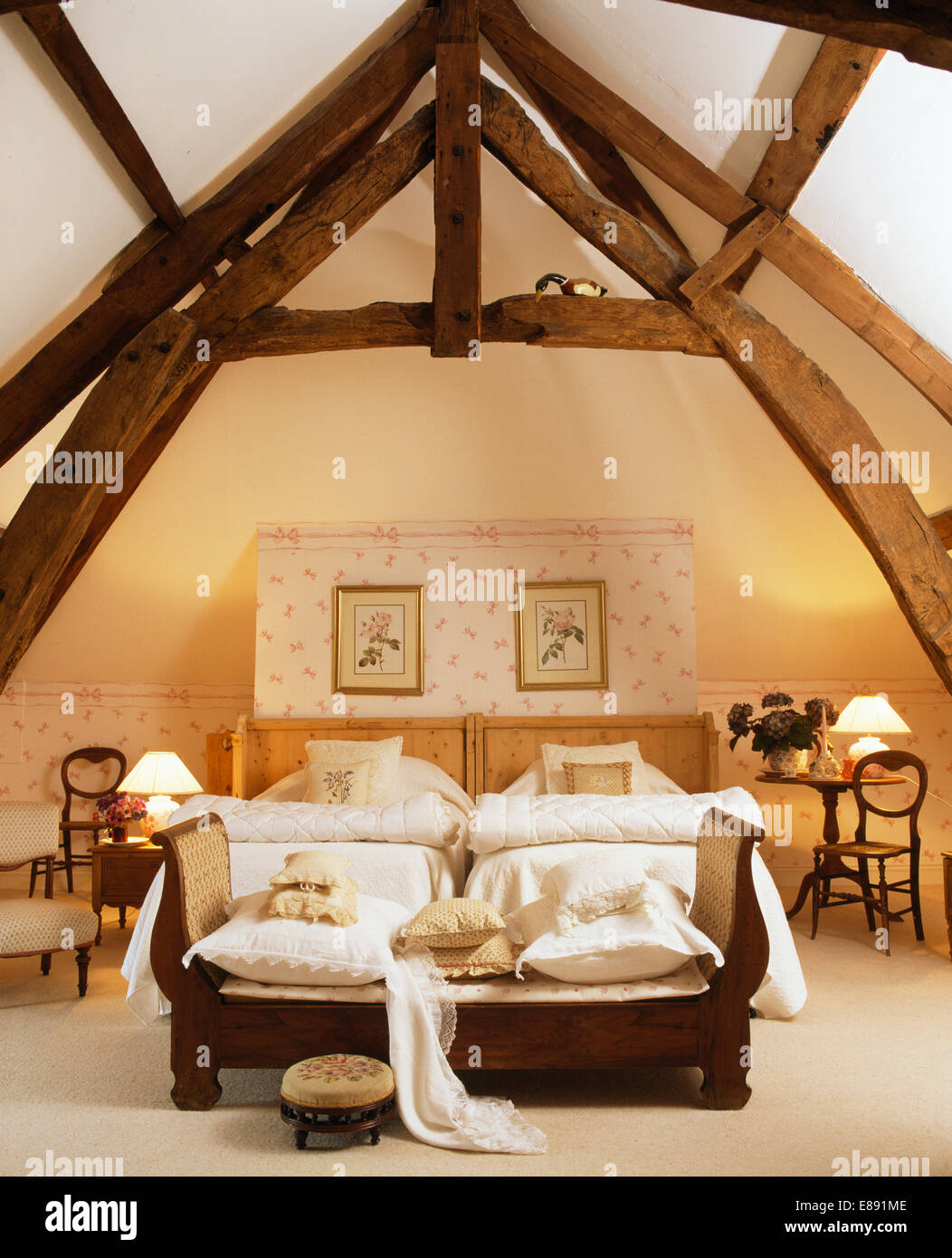 High, Beamed Apex Ceiling In French Country Bedroom With Sofa At The Foot  Of Twin Beds With White Quilts