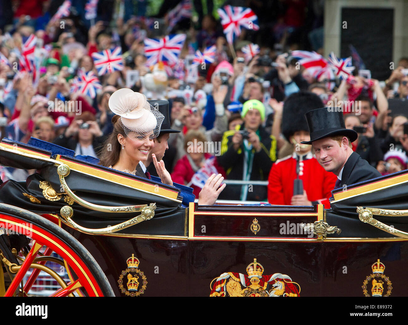 The Duchess of Cambridge,Catherine Middleton,her husband,William and Prince Harry ride down the Mall Stock Photo