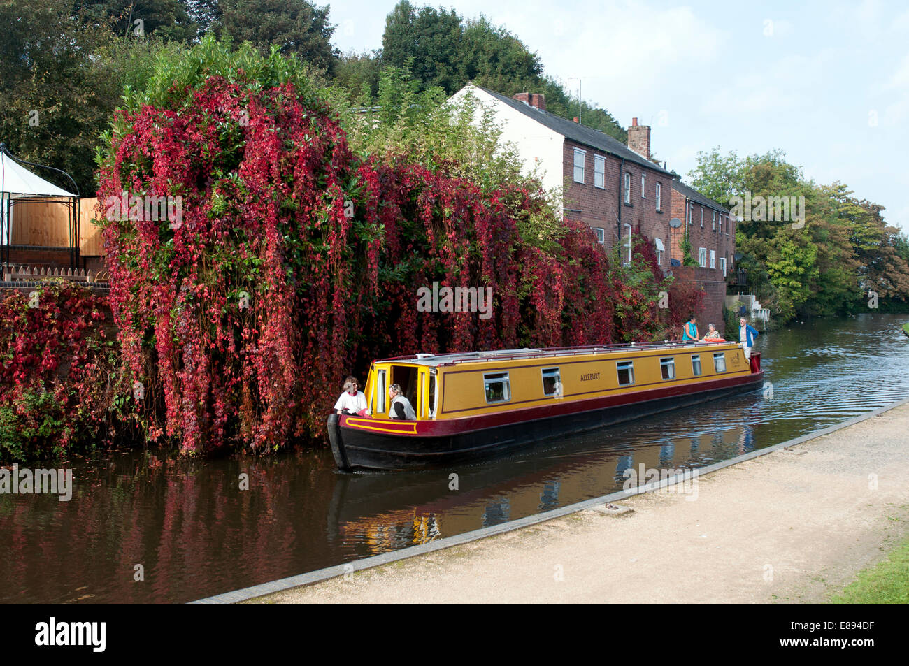 Narrowboat on the Staffordshire and Worcestershire Canal in autumn, Kidderminster, Worcestershire, UK Stock Photo