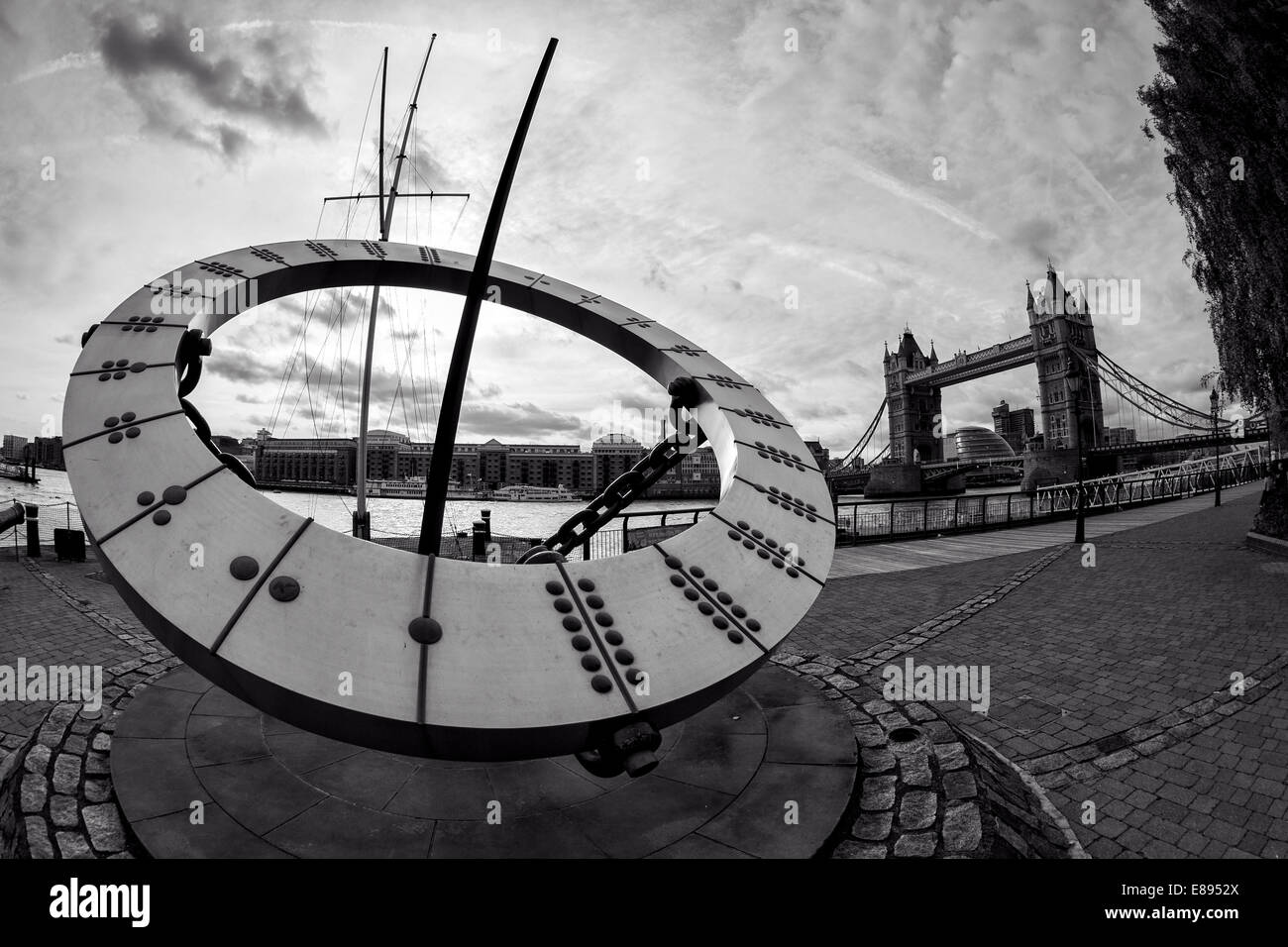 Close Up of Sundial at St Katharine's Dock with Tower Bridge and Butler's Wharf in Background - Stock Image