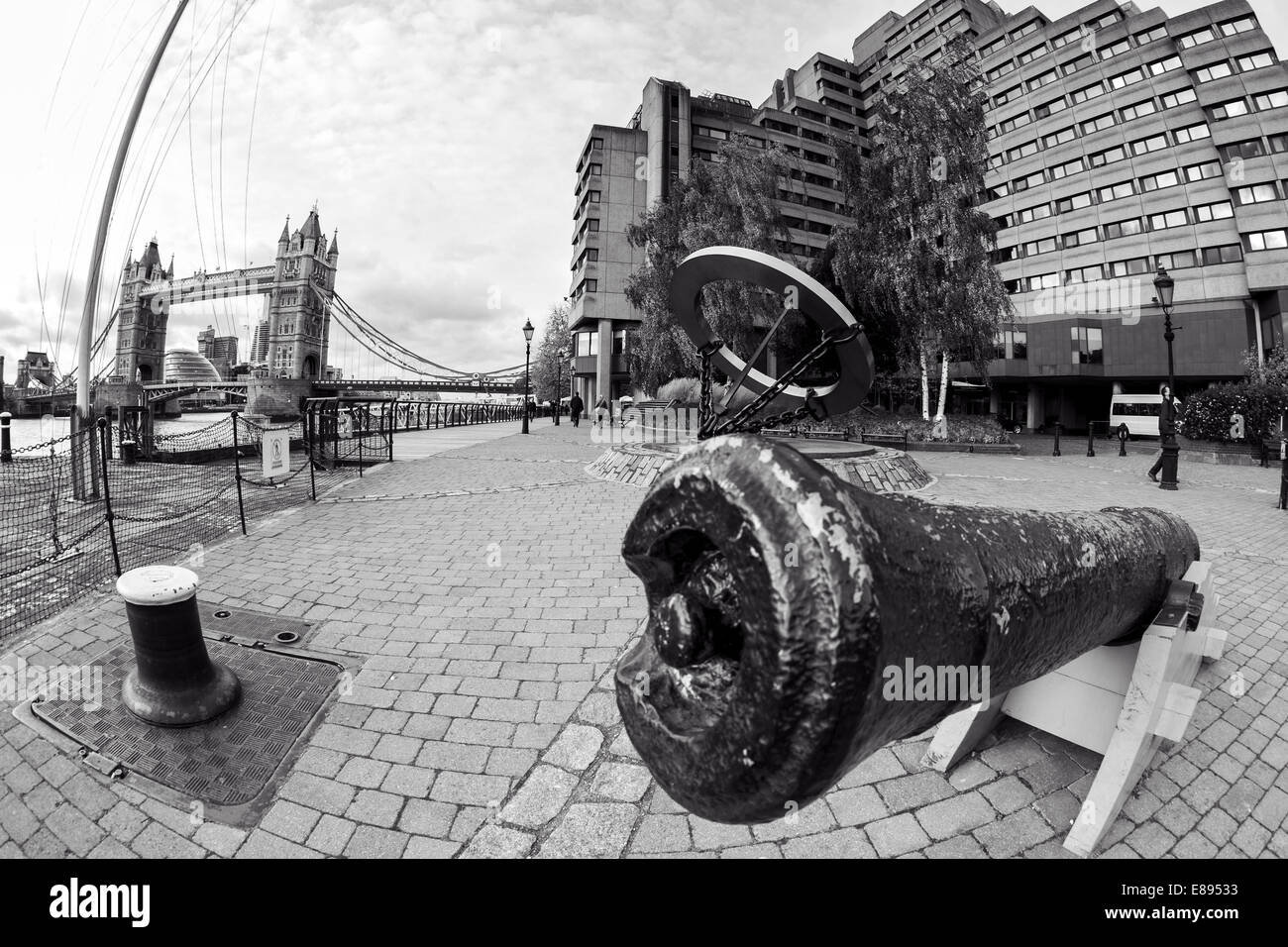 Cannon guarding Thames entrance to St Katharine's Dock, London - Stock Image