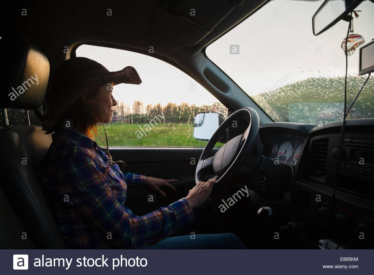Rancher driving truck - Stock Image