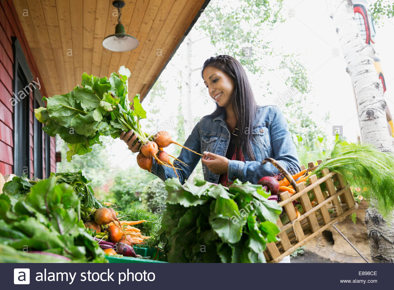 Woman shopping for fresh produce outside market - Stock Image