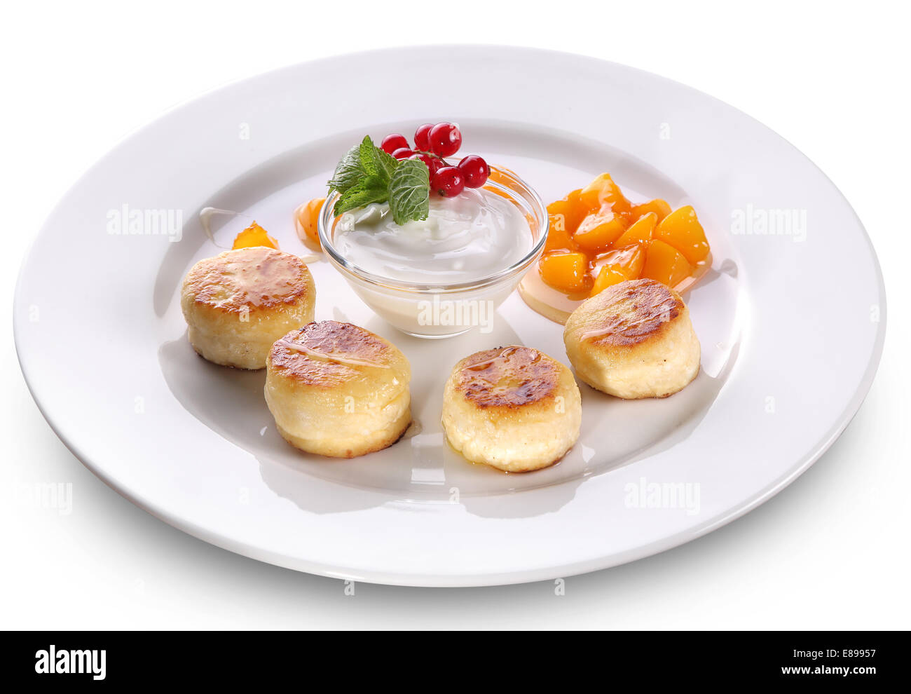 Cheese cakes on a white plate. File contains clipping paths. - Stock Image