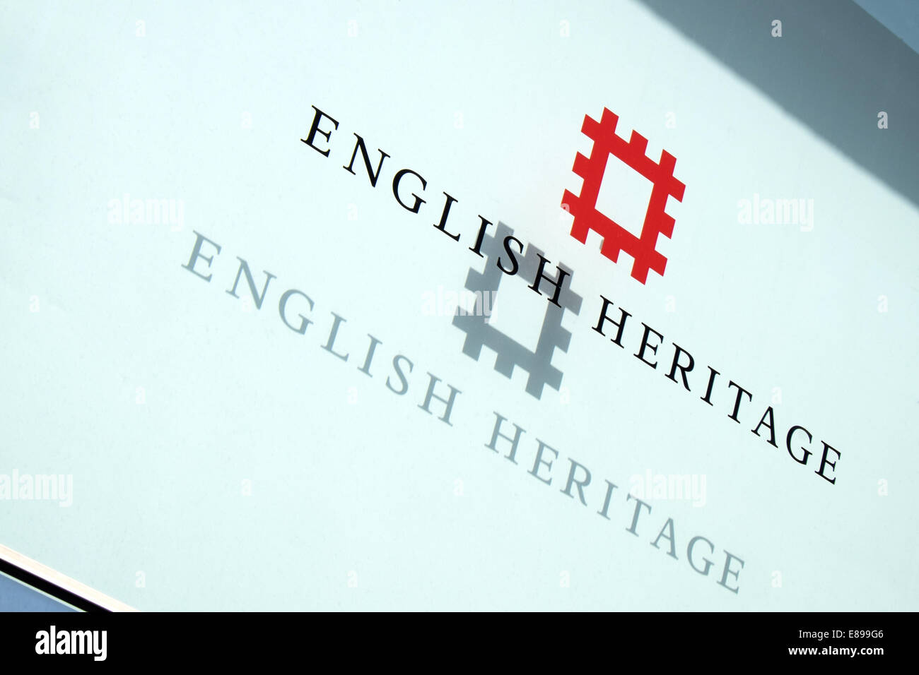 The English Heritage logo & text on a glass panel with shadow projected behind at their offices in Swindon, - Stock Image