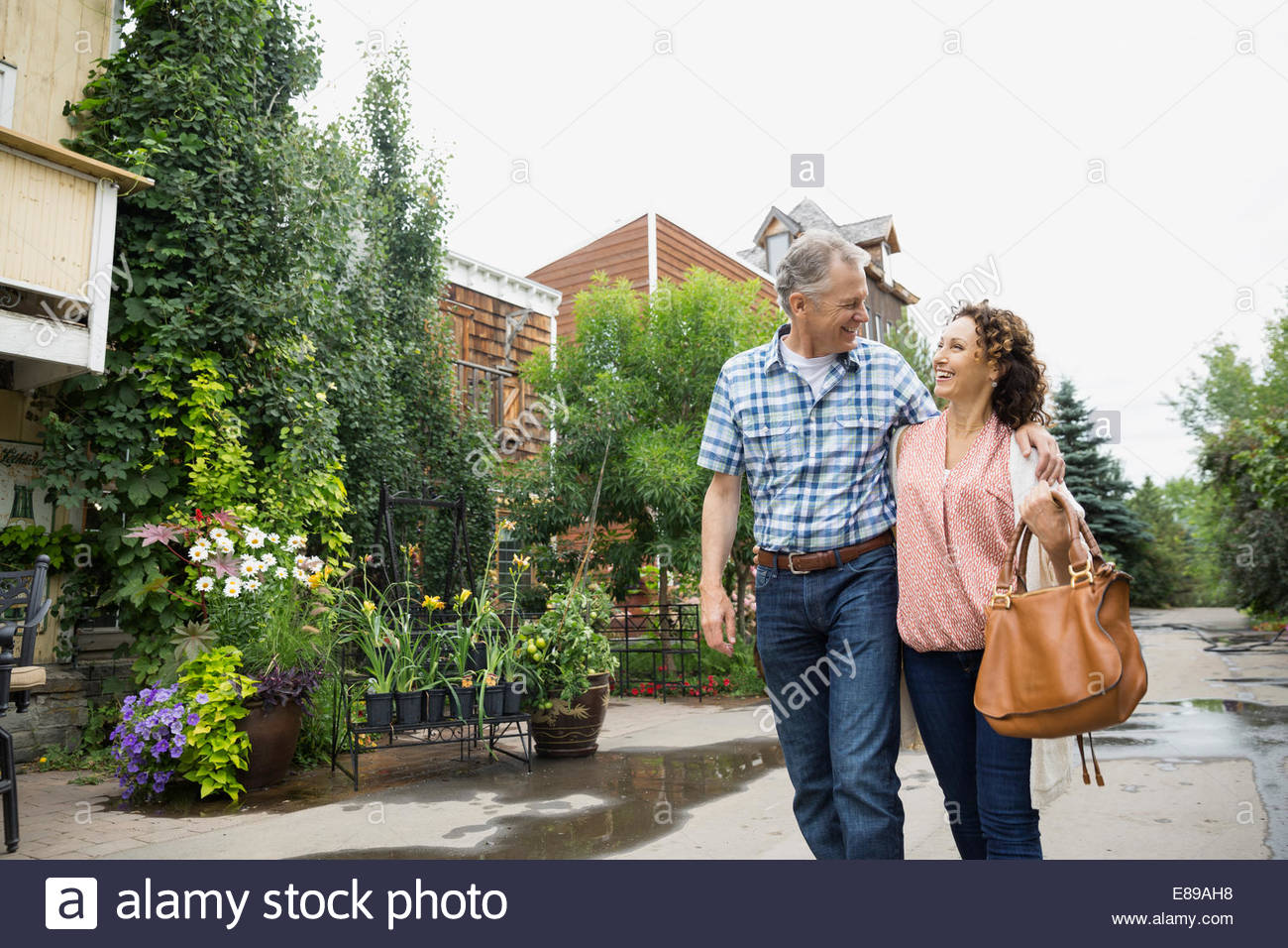 Couple walking outside plant nursery - Stock Image