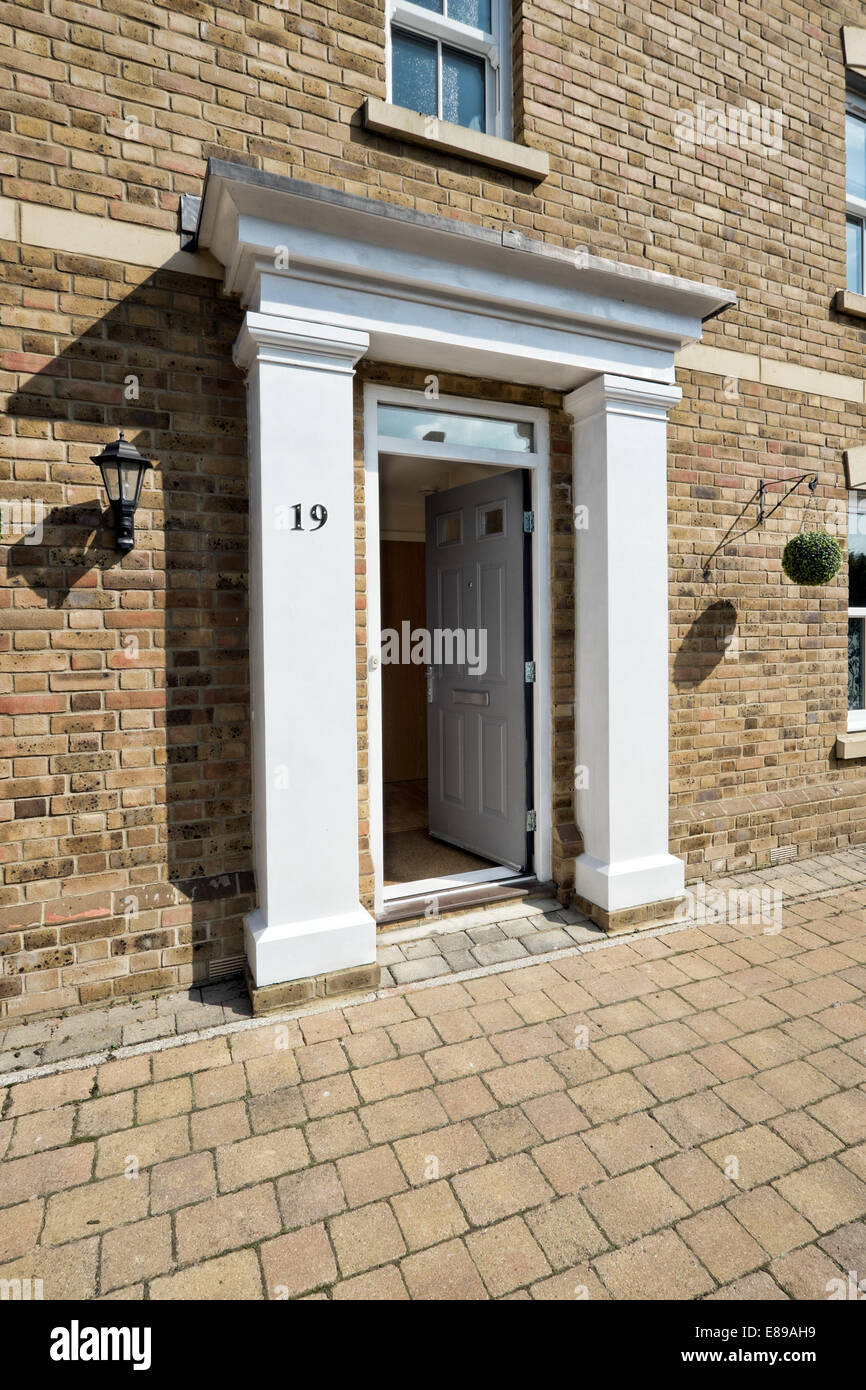 A small portico surrounding the front door of a modern development home in the English town of Swindon, Wiltshire, - Stock Image