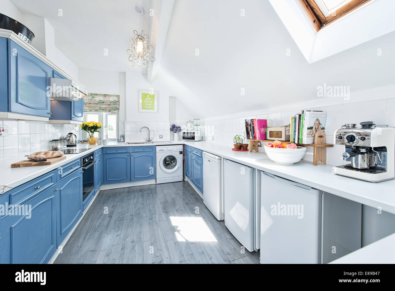 A light, airy, apartment kitchen in a loft conversion Stock Photo ...