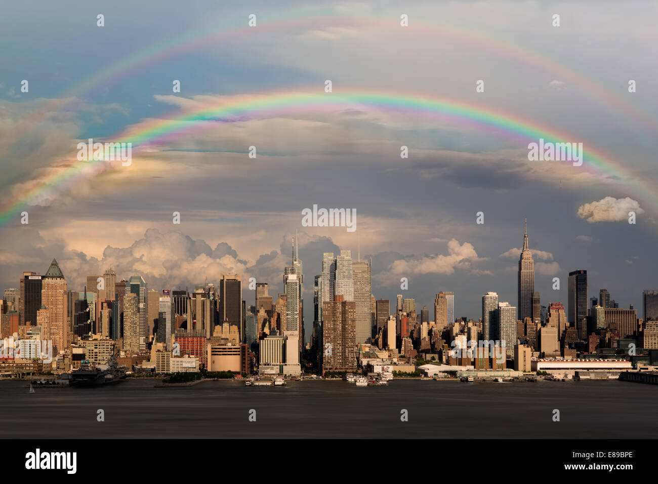Rainbows over the New York City Skyline after a Thunder Storm. - Stock Image
