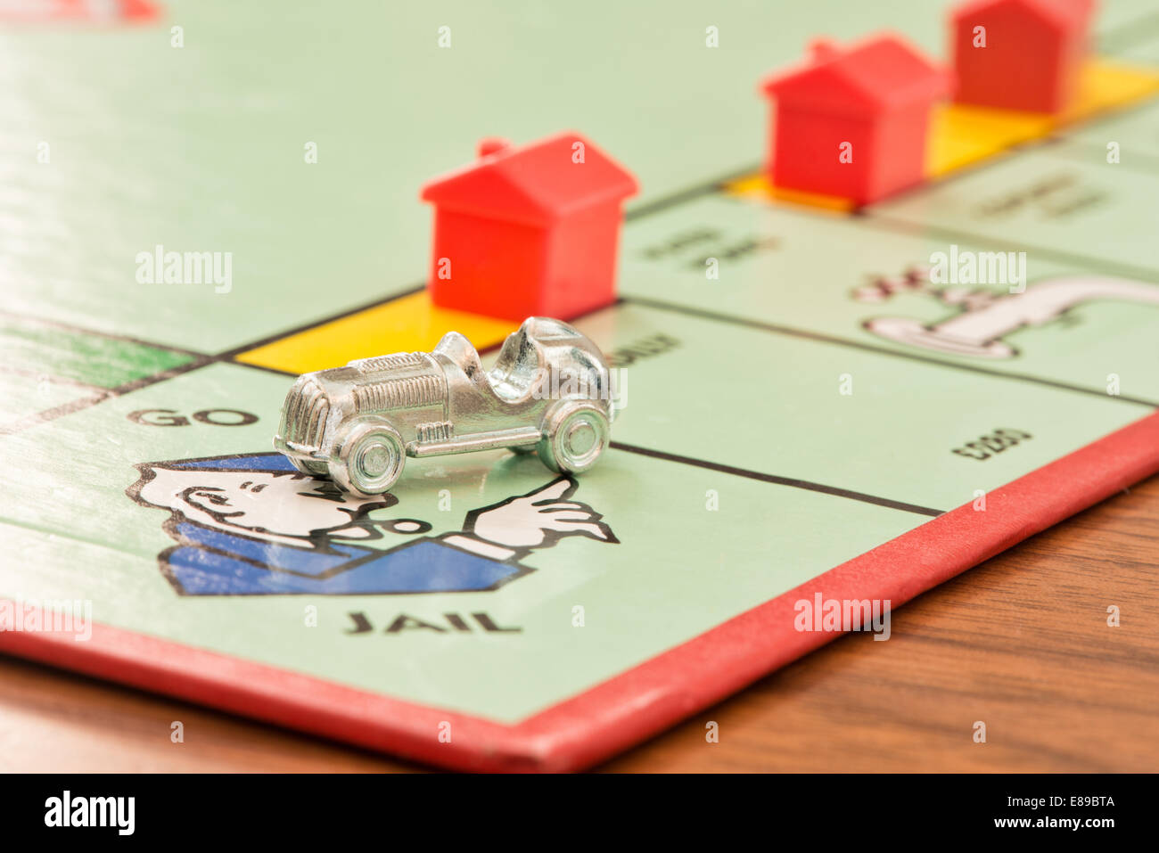 The metal car charm on the go to jail square of the Waddingtons Monopoly board game - Stock Image