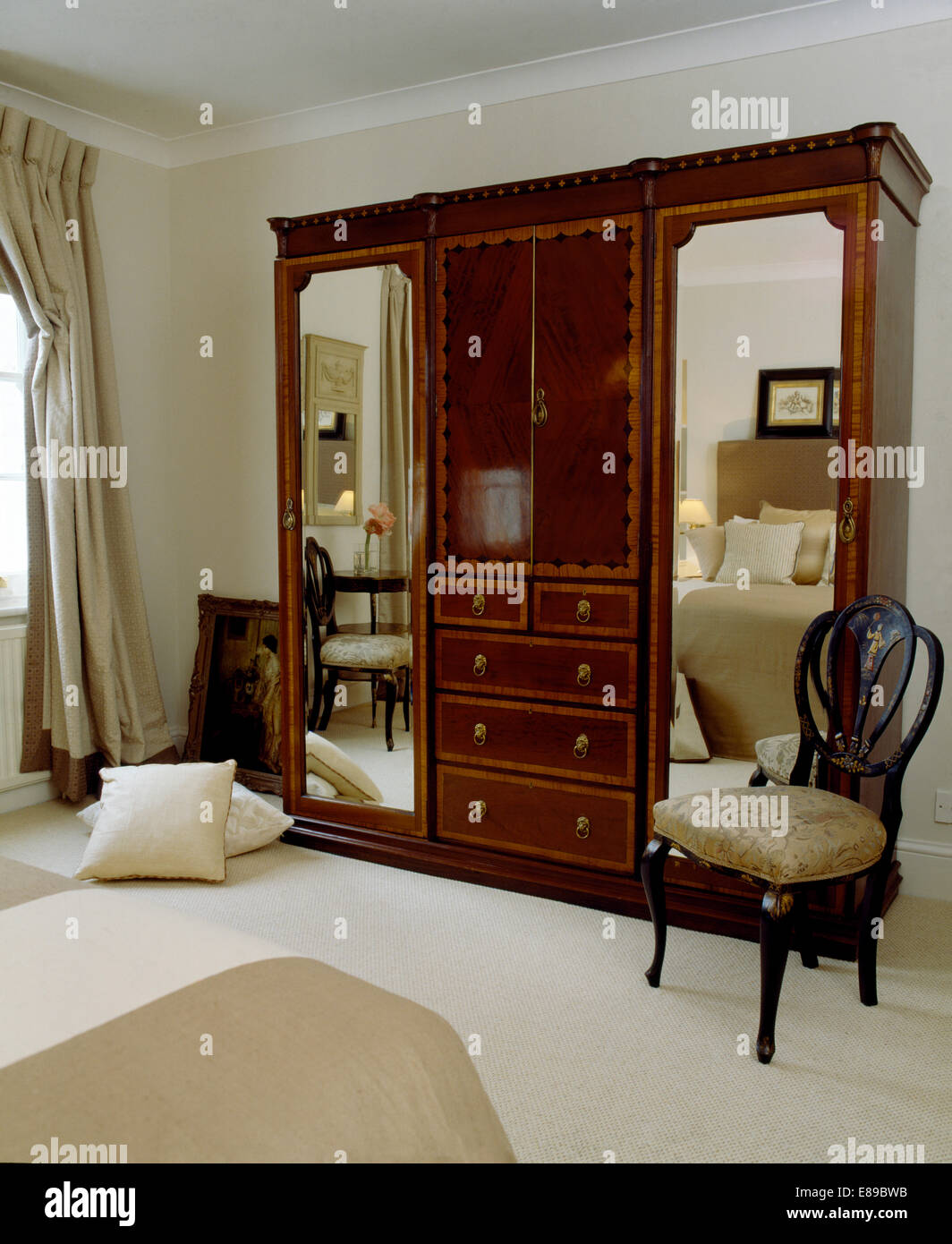 buy popular db58f bb845 Antique chair beside large wardrobe with mirrored doors in ...