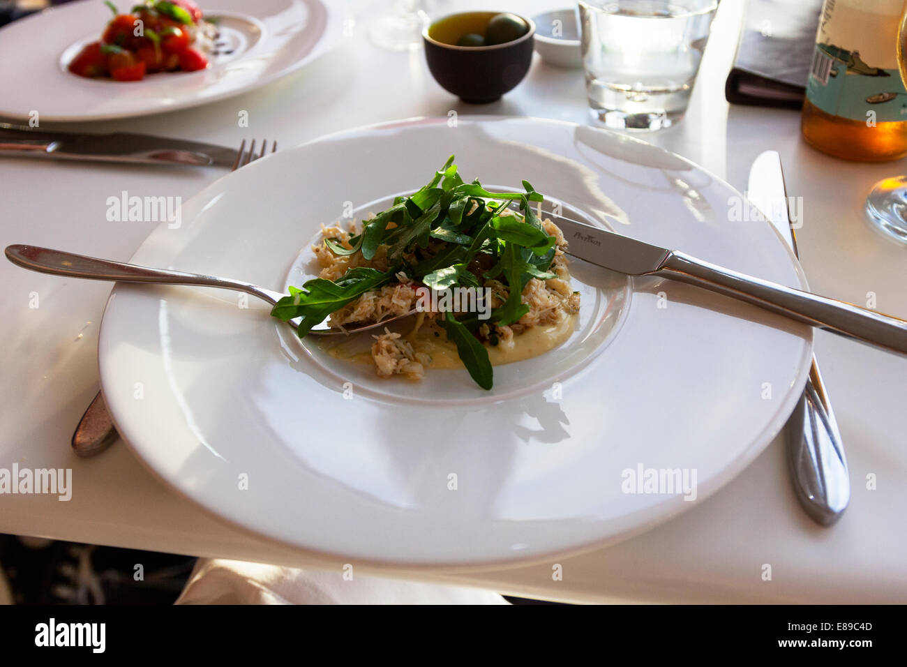 Crab and rocket salad food meal Fifteen Jamie Oliver's Cornwall Cornish west country typical food - Stock Image