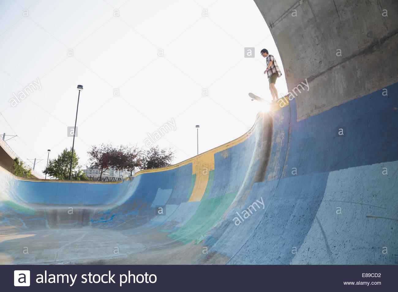 Teenage boy on ramp at skateboard park - Stock Image
