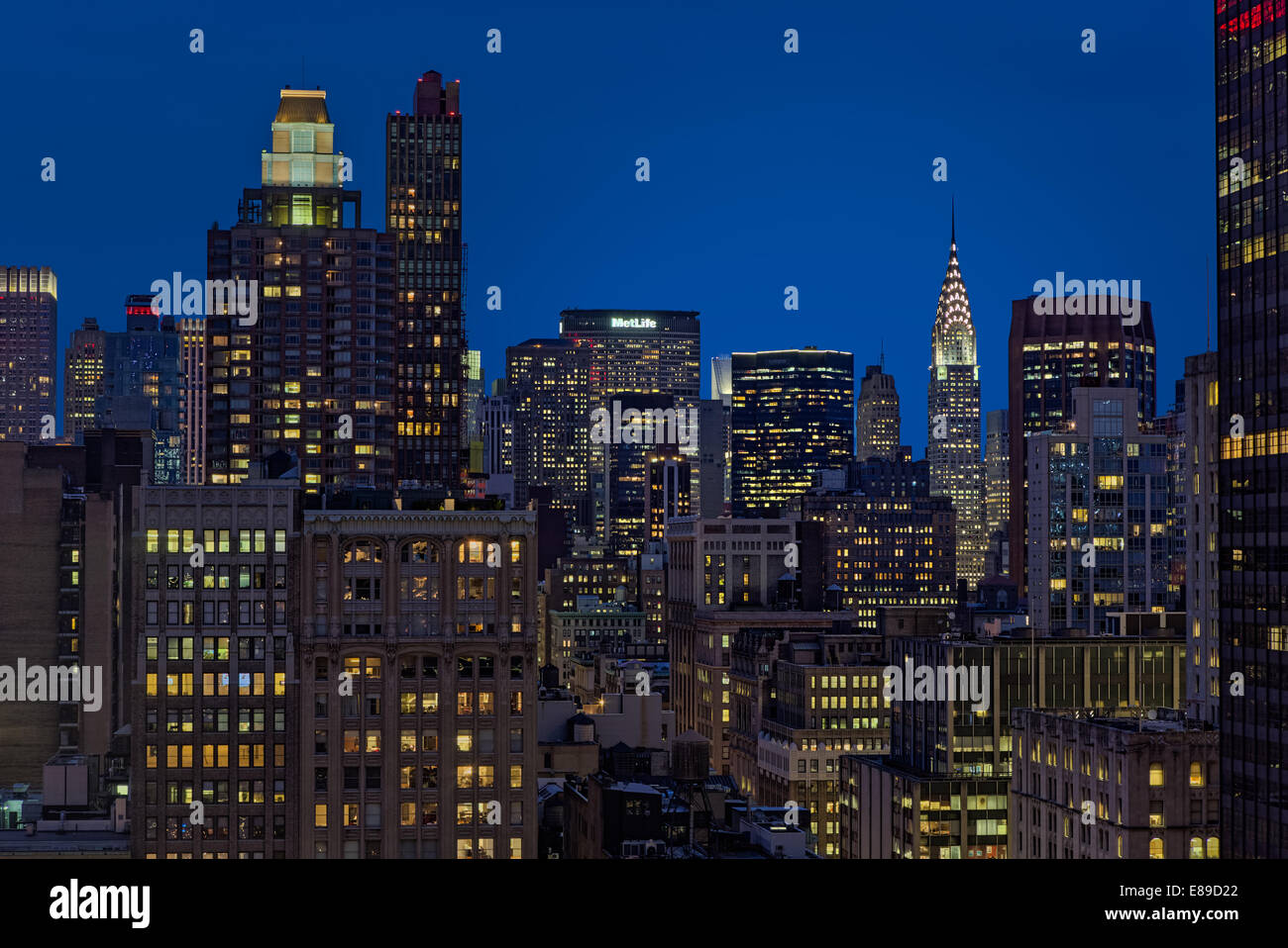 The Chrysler Building and the Met Life Building along with other New York City skyline skyscrapers during the blue - Stock Image