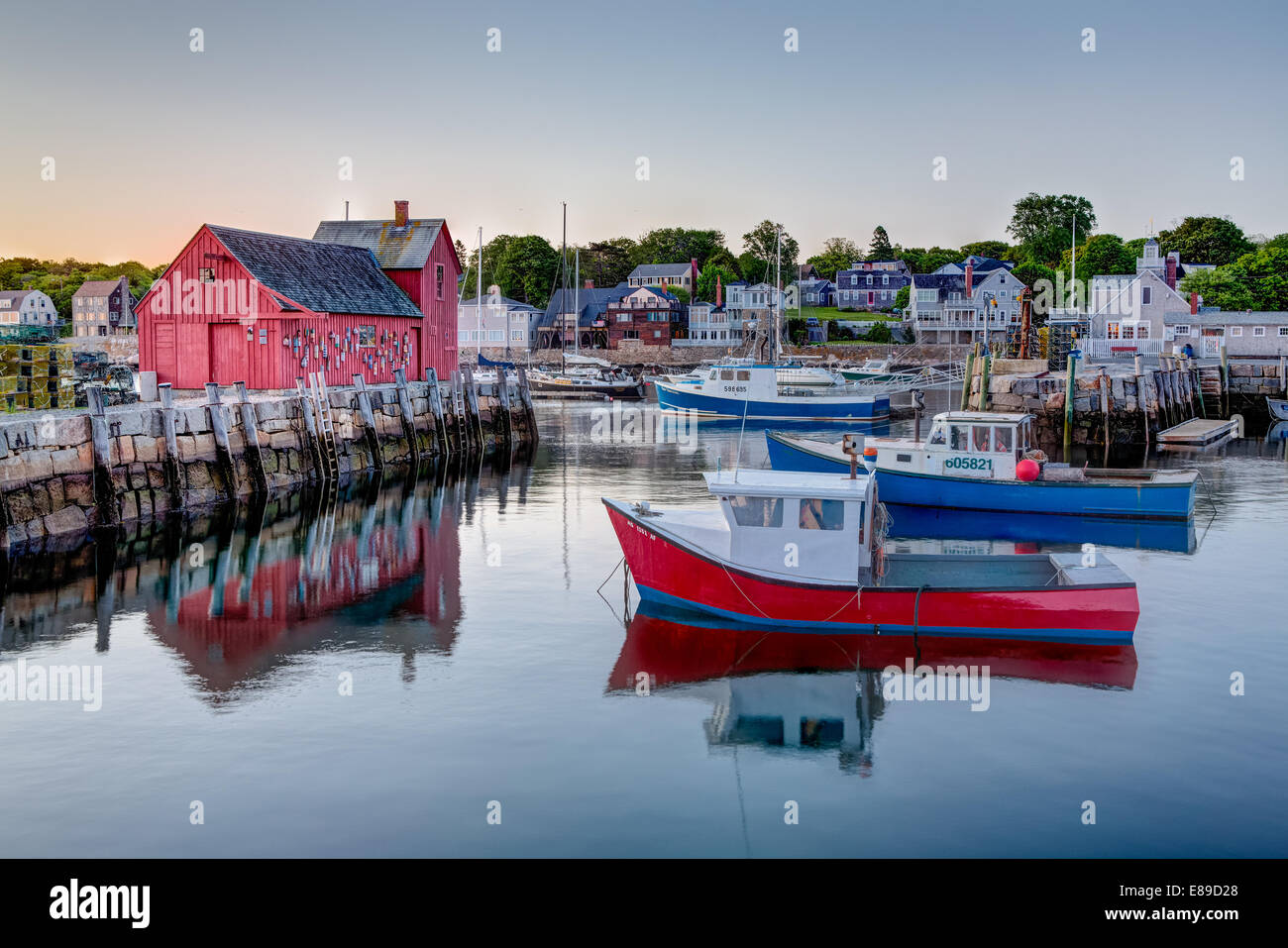 The quintessential New England Motif Number One sunrise. Located on Bradley Wharf in the harbor town of Rockport. - Stock Image