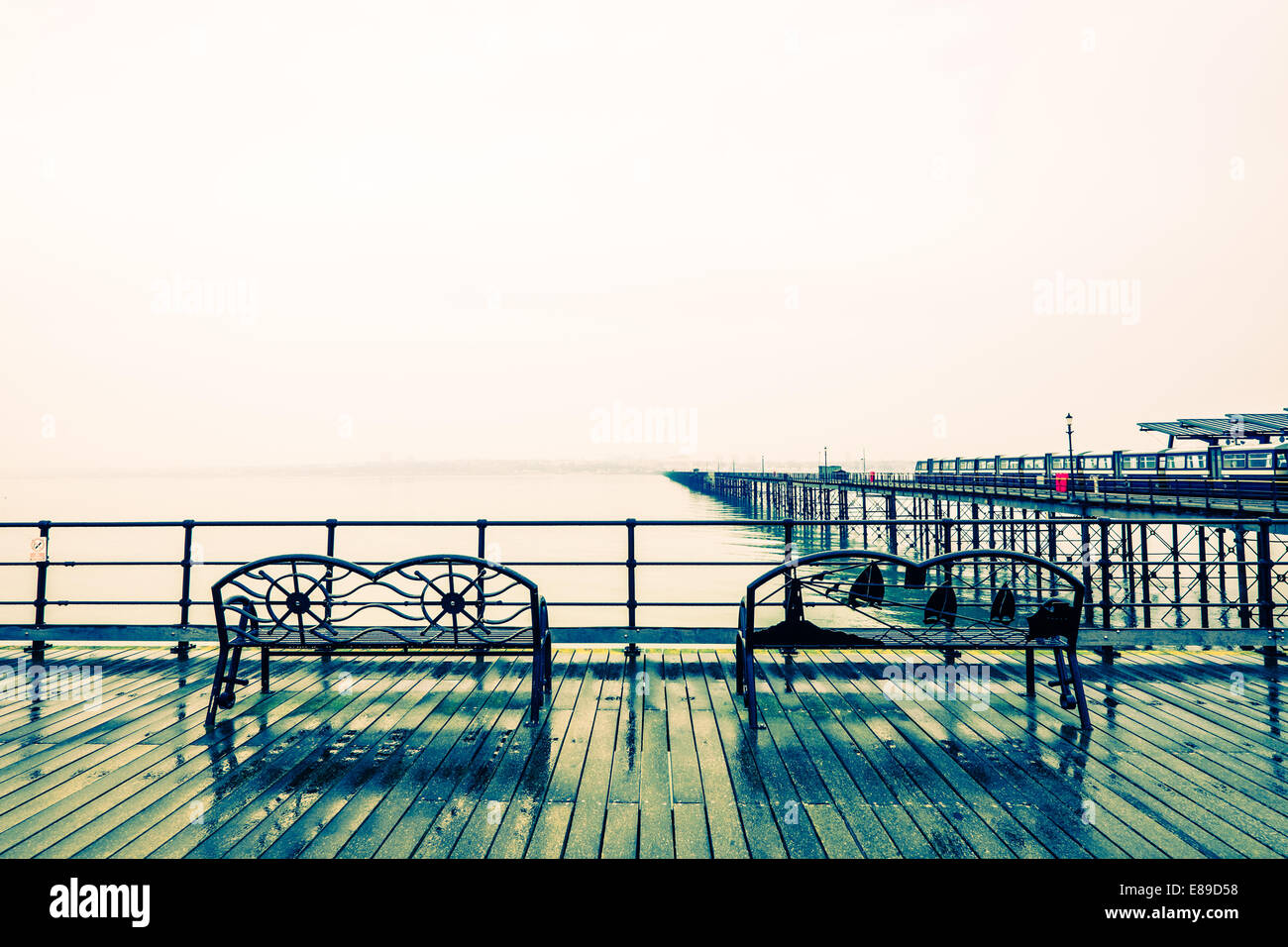 Southend Pier with yellow cross process effect - Stock Image