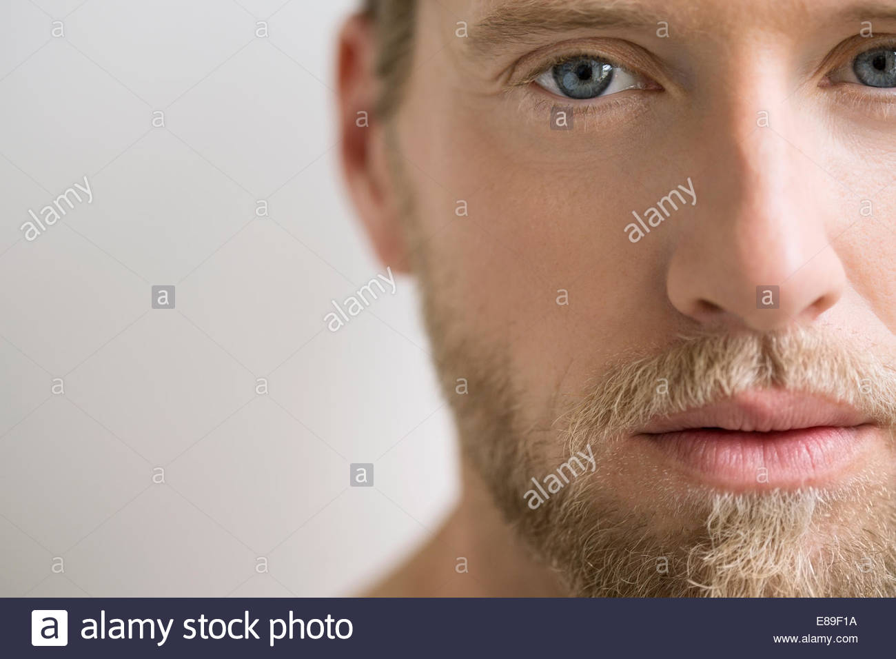 Close up portrait of man with blonde hair - Stock Image