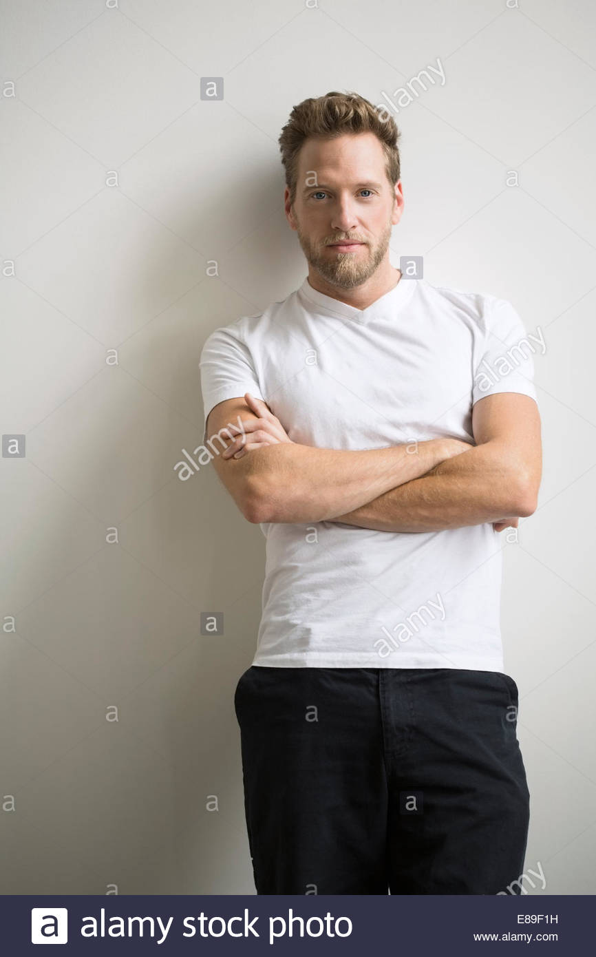 Portrait of confident blonde man with arms crossed Stock Photo