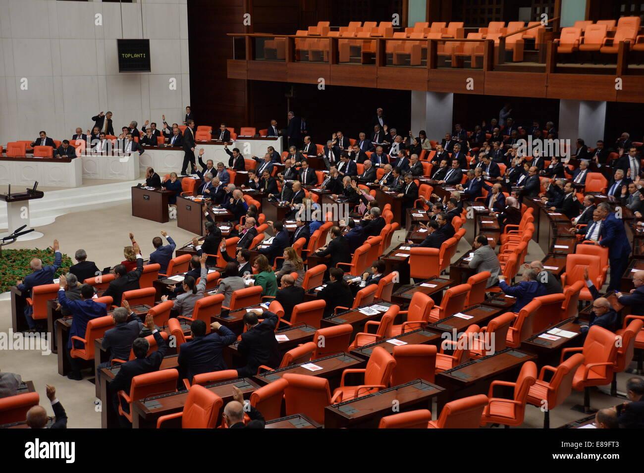 Ankara, Turkey. 2nd Oct, 2014. Turkey's lawmakers attend a meeting at the Turkish parliament in Ankara, Turkey, - Stock Image