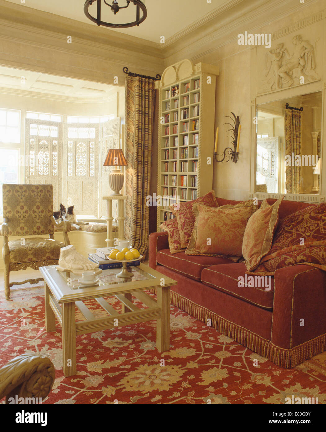 red cream living room patterned cushions on sofa with fringed edging in 14671