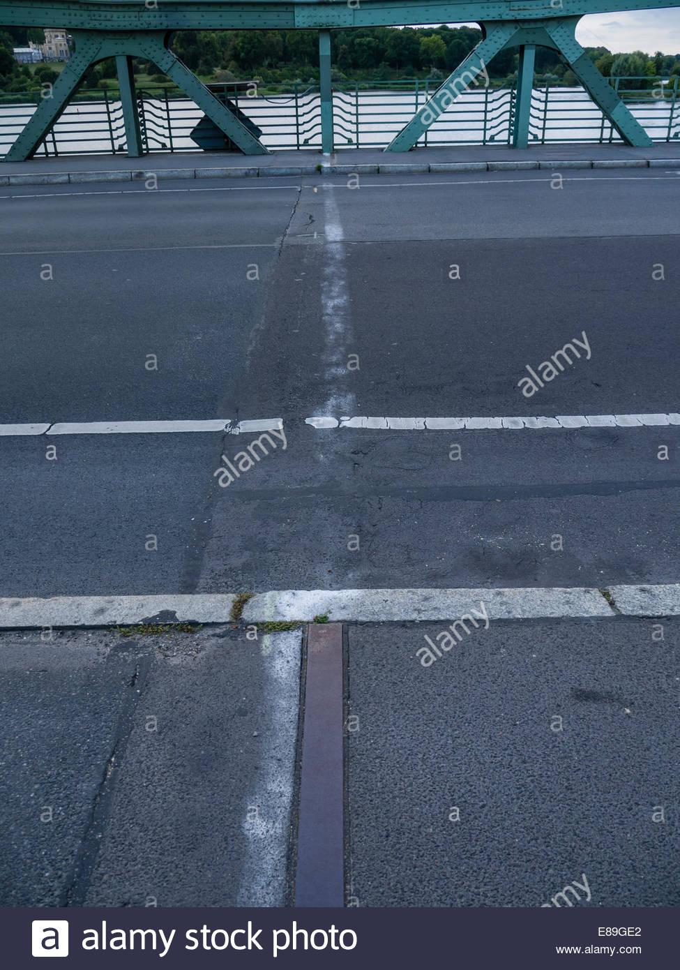 "Berlin,Potsdam fading demarcation line East West on the centre Glienicke Bridge of Spies ""Bridge of Unity' - Stock Image"