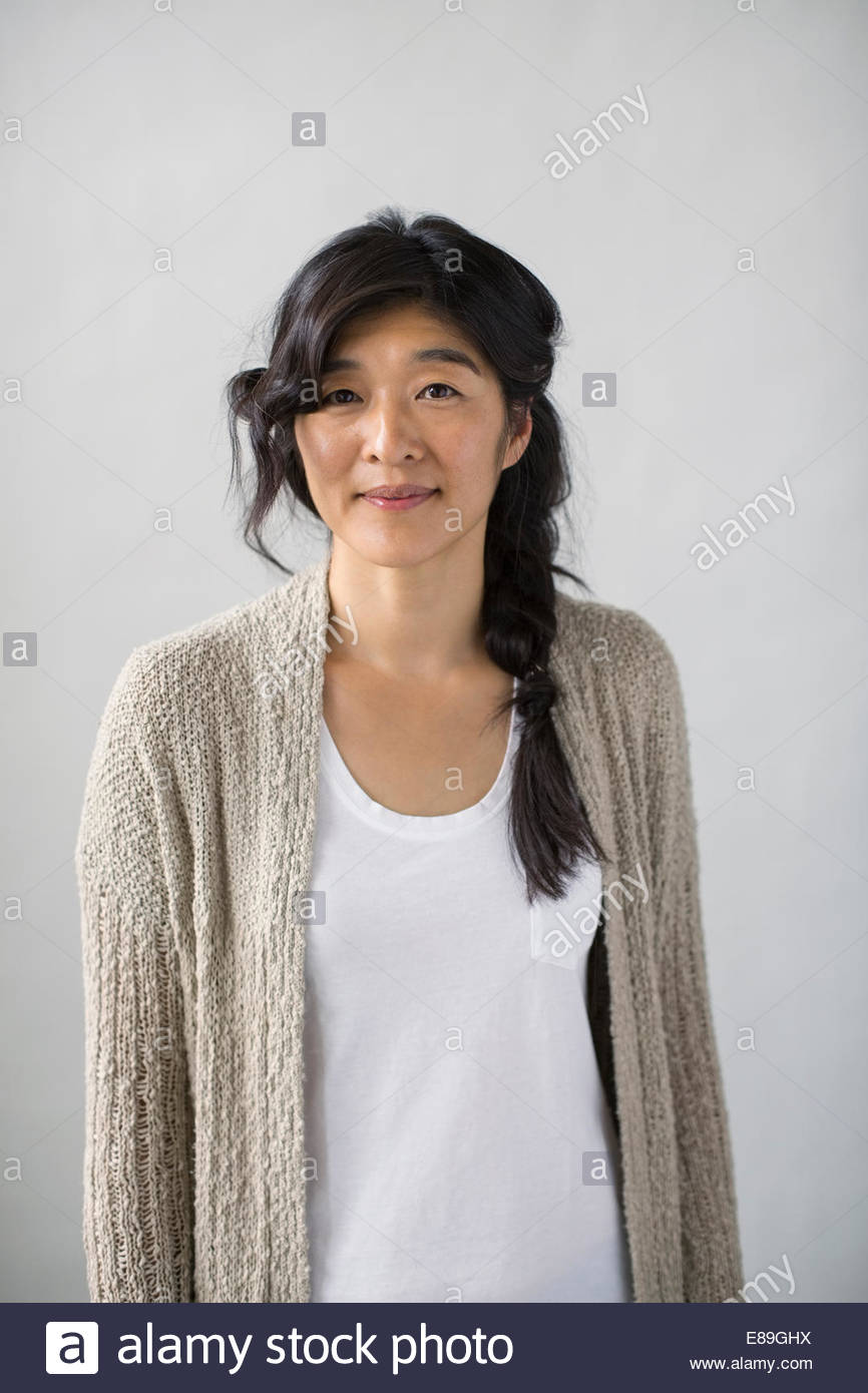 Portrait of casual woman with braided black hair - Stock Image
