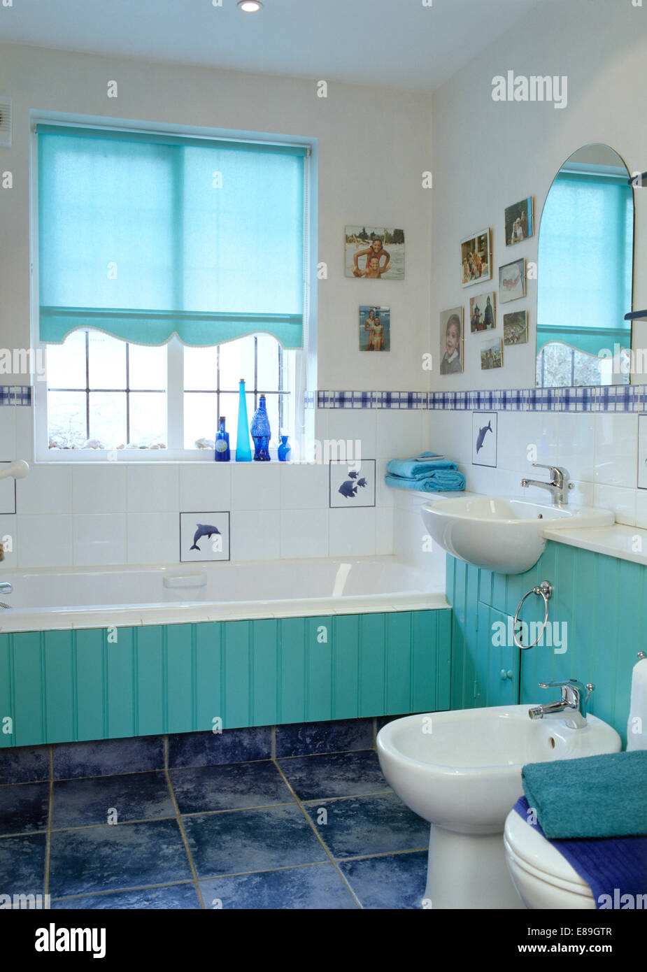 Turquoise blind on window above turquoise tongue+groove panelled ...