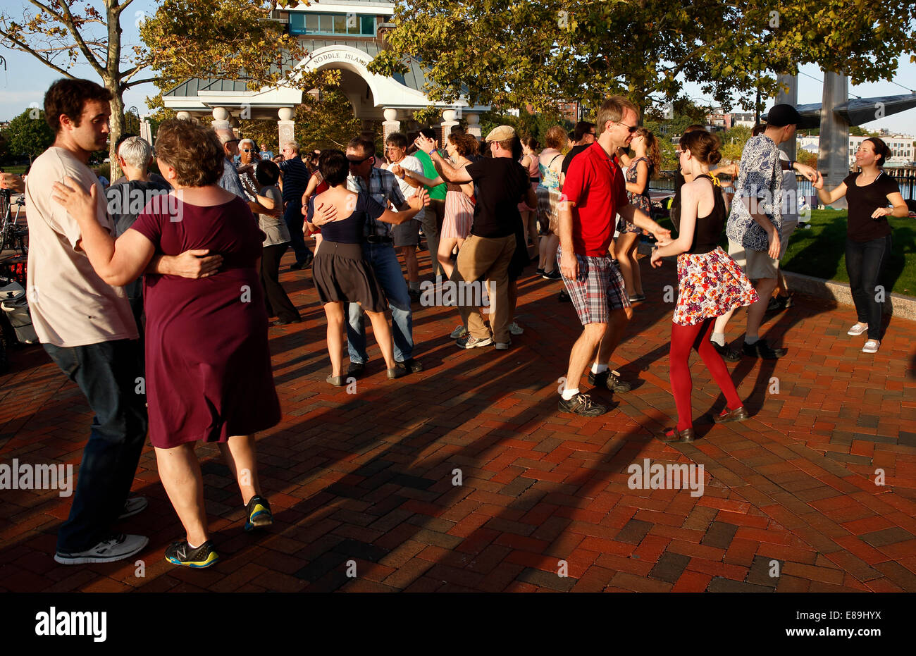A Group Of People Swing Dancing In Piers Park Boston