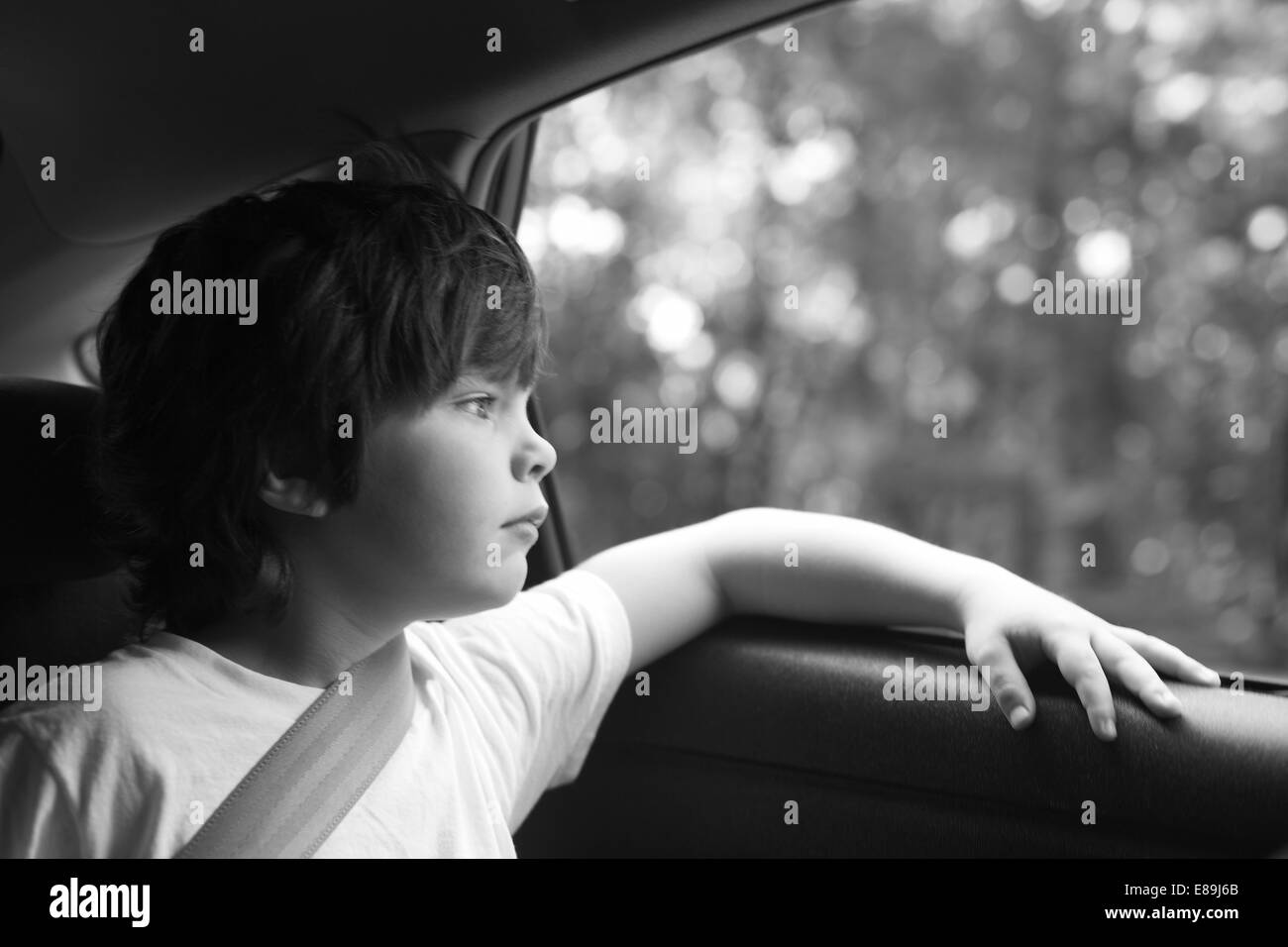 Boy lost in thought in the car, roadtrip - Stock Image