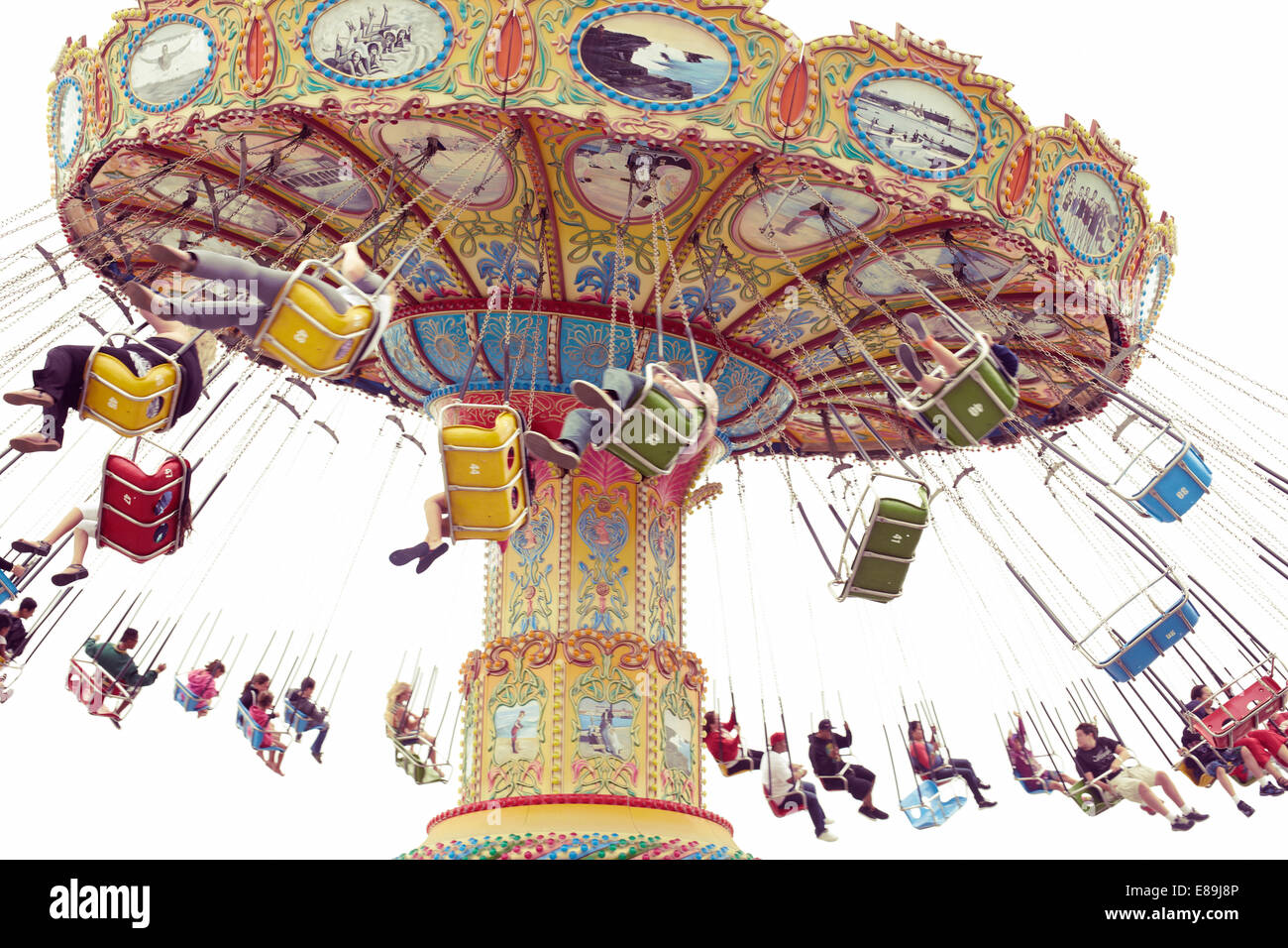 Spinning swings at fair - Stock Image