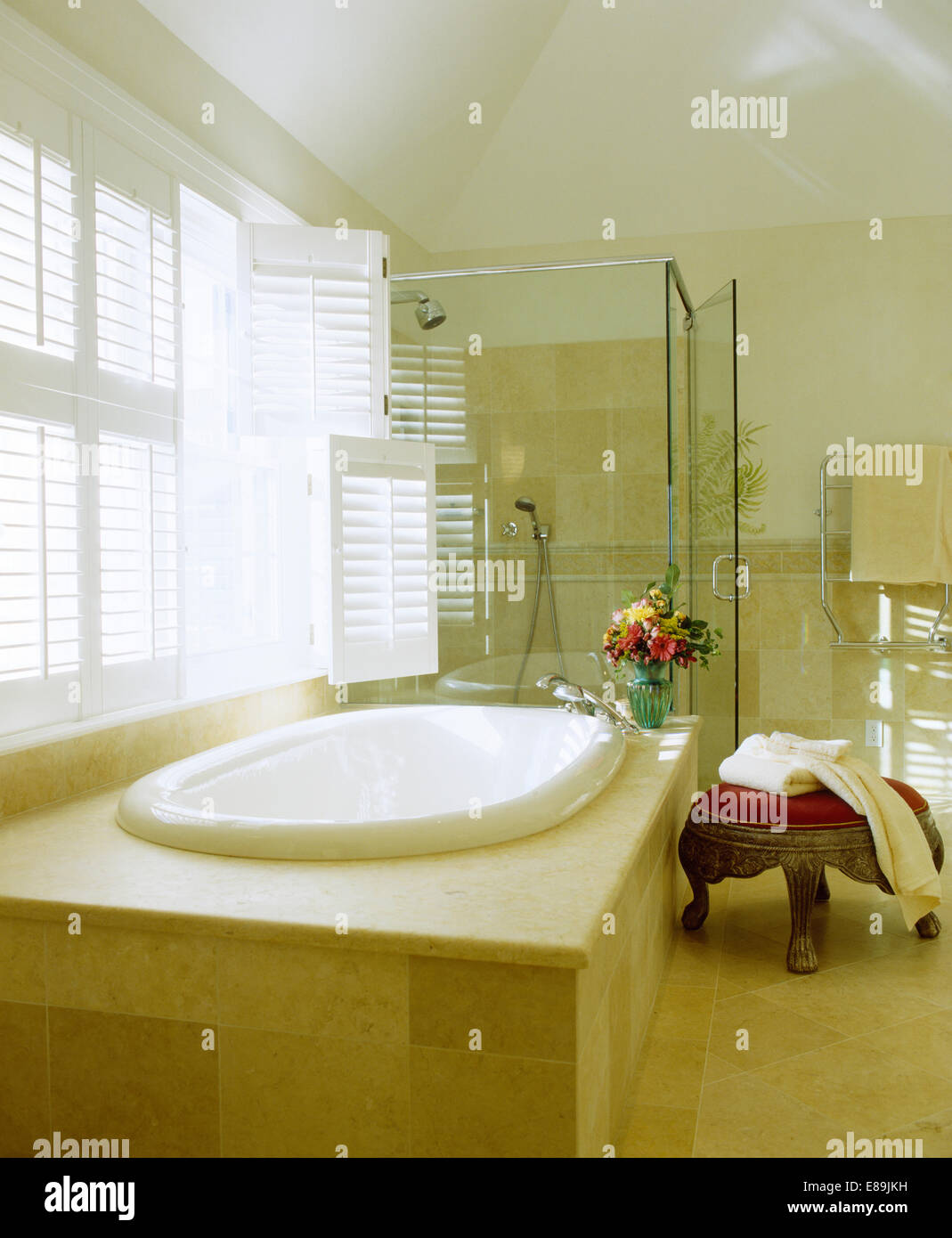 Plantation Shutters On Window Above Bath With Tiled Paneling