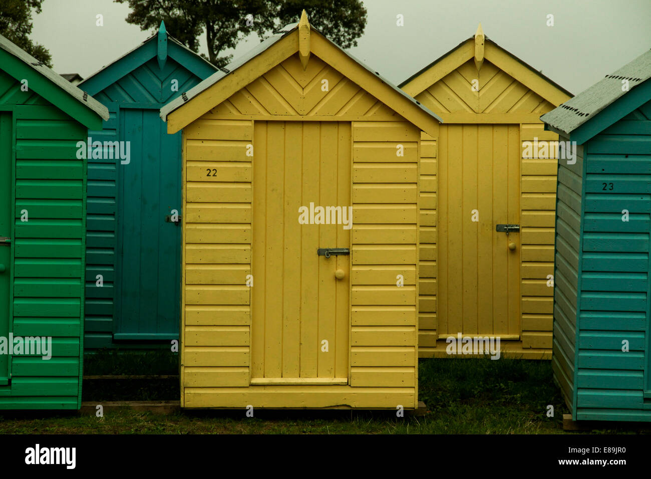 Brightly colored bathing huts - Stock Image