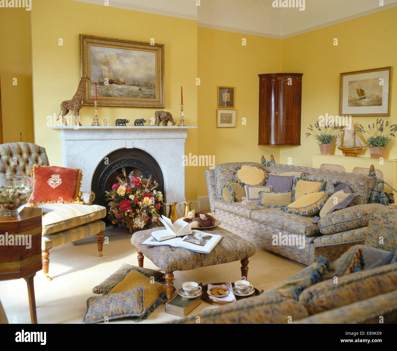 Grey patterned sofas in traditional yellow living room Stock ...