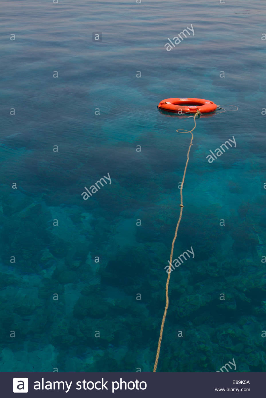 Life belt floating on water - Jordan Stock Photo