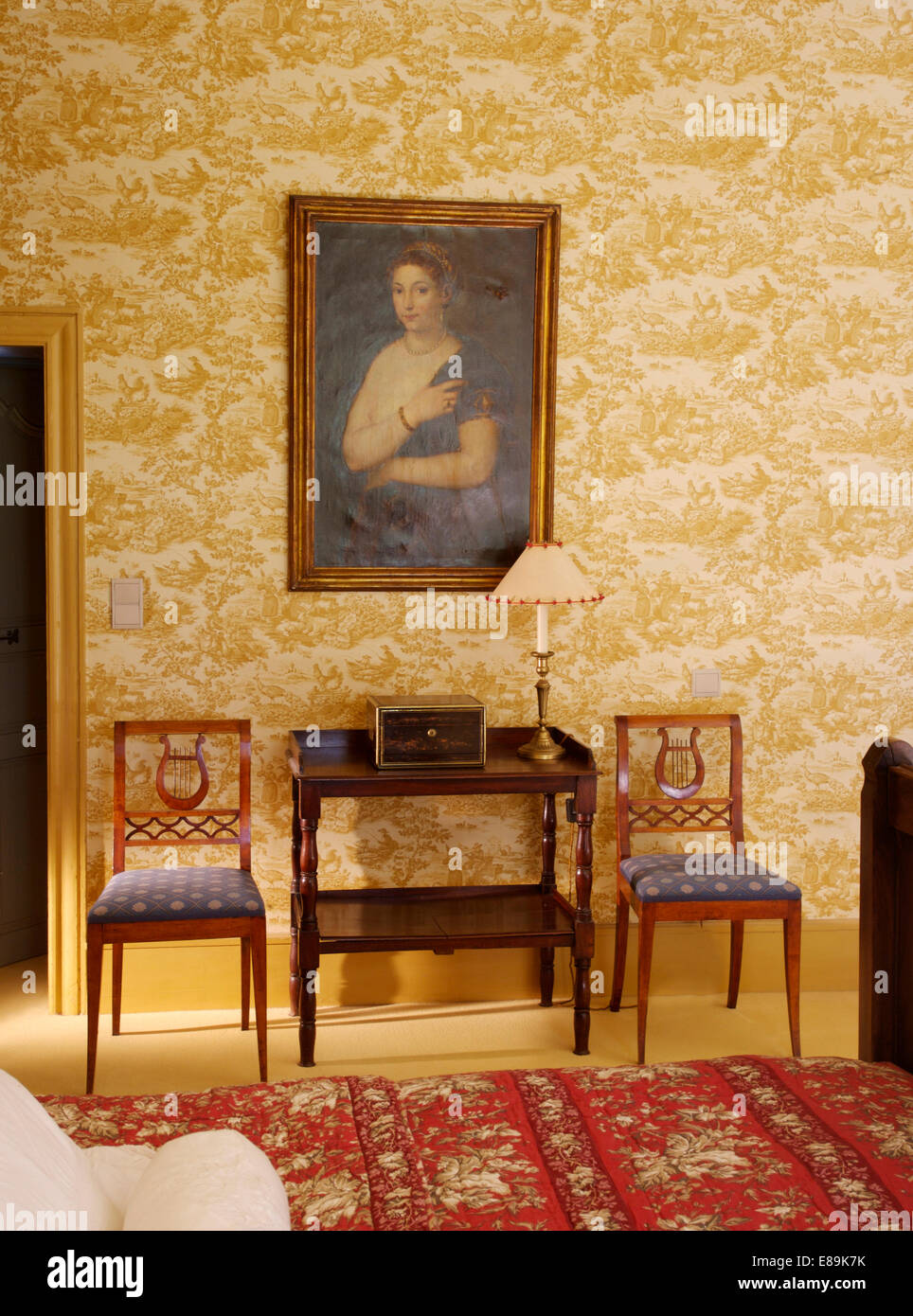 Large portait on wall above antique console table and chairs in ...