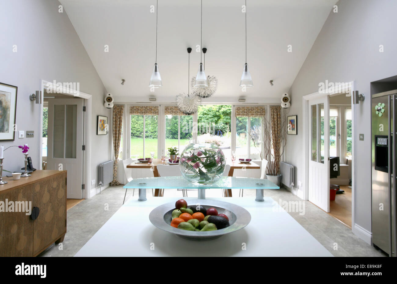 Pendant Lighting Above Island Unit In Large Modern Kitchen And Dining Room
