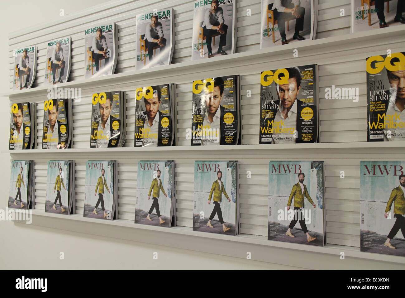 Copies of GQ, MWR and Menswear Fashion Magazines on a shelf at London Fashion week - Stock Image
