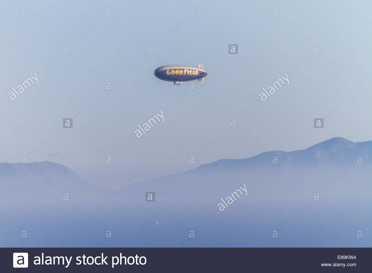 View of flying Goodyear blimp - USA - California - Stock Image