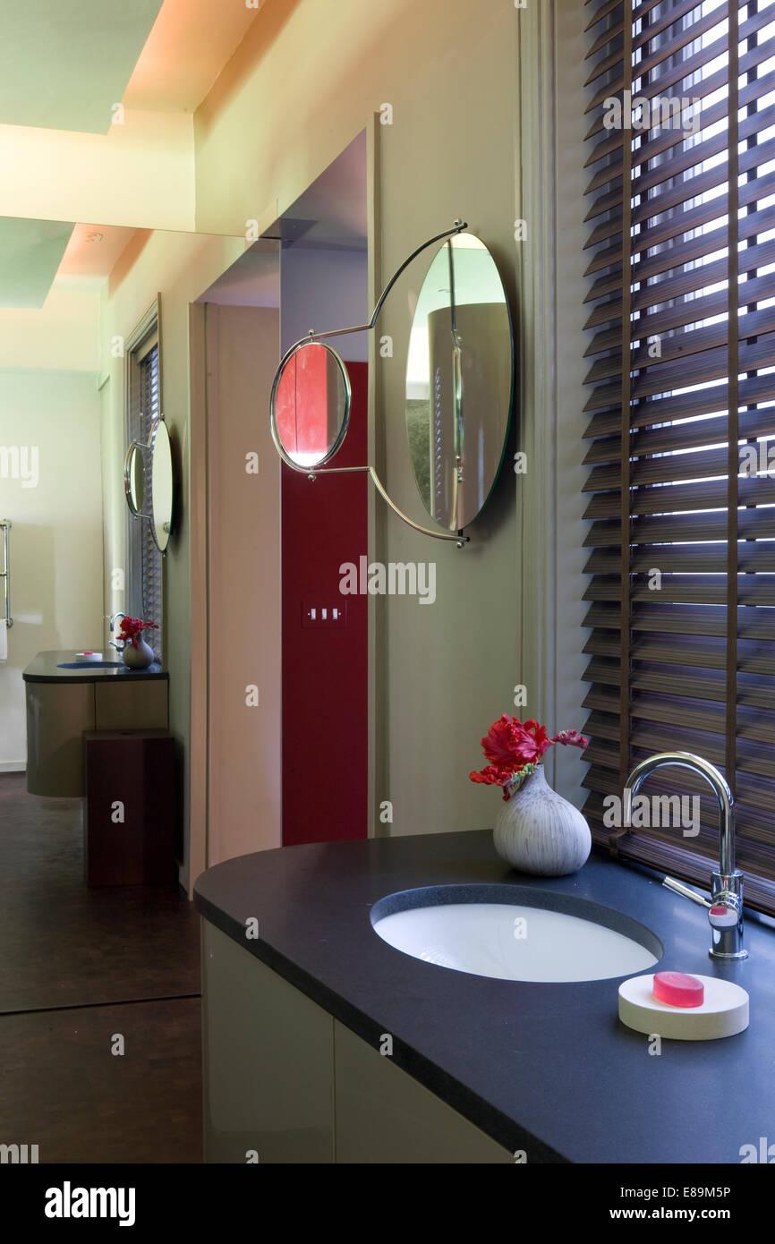 Venetian blind above washbasin in vanity unit in modern  bathroom - Stock Image
