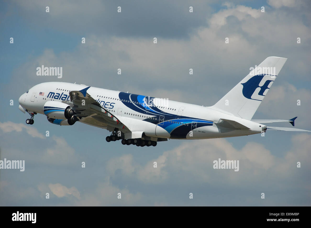 Malaysia Airlines Airbus A380-800 (9M-MNA) departs London Heathrow Airport, England. - Stock Image