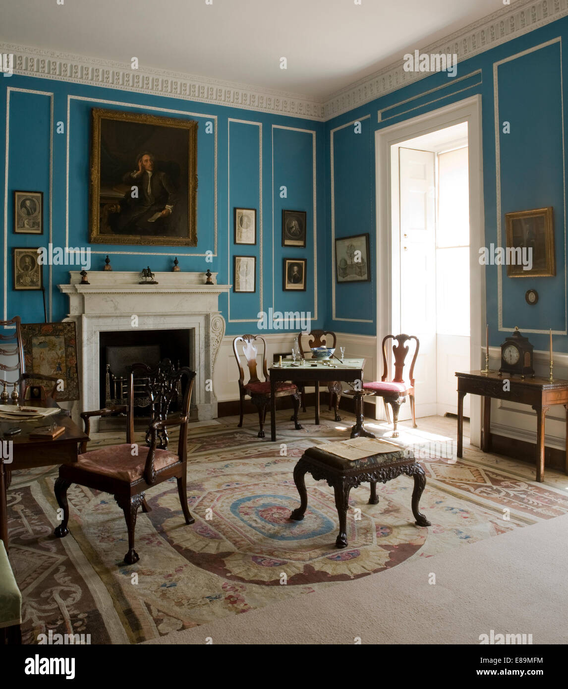 Antique Furniture In Blue Country House Drawing Room With Antique Furniture
