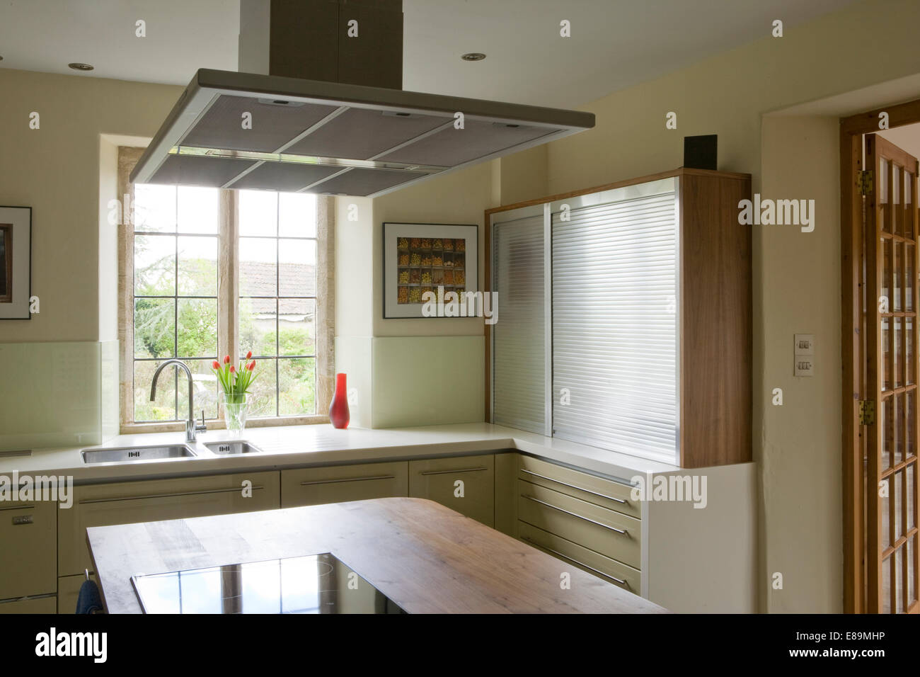 Extractor fan above central island unit in modern kitchen Stock ...