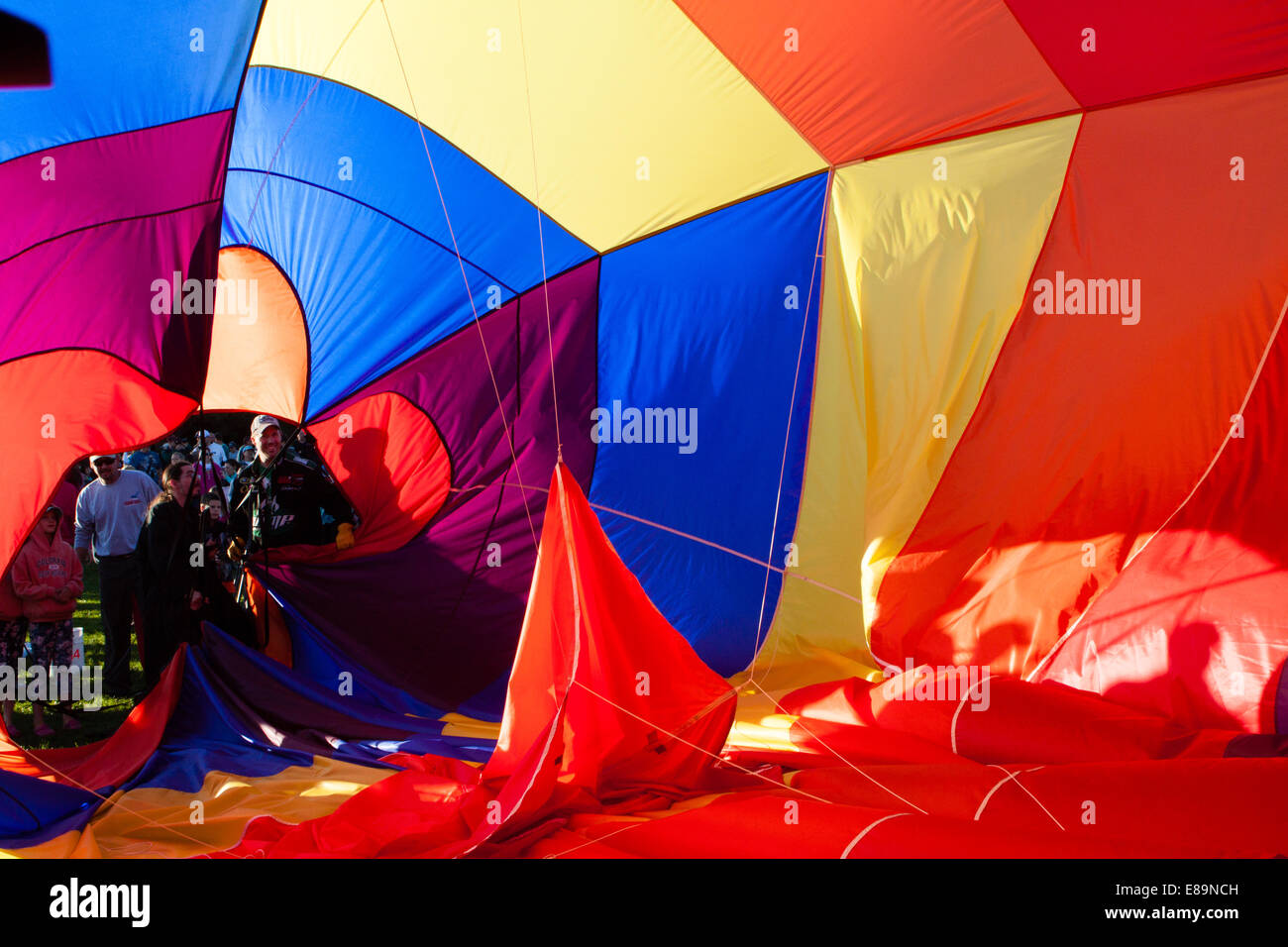 View from inside a partially inflated balloon canopy being collapsed for storage - Stock Image
