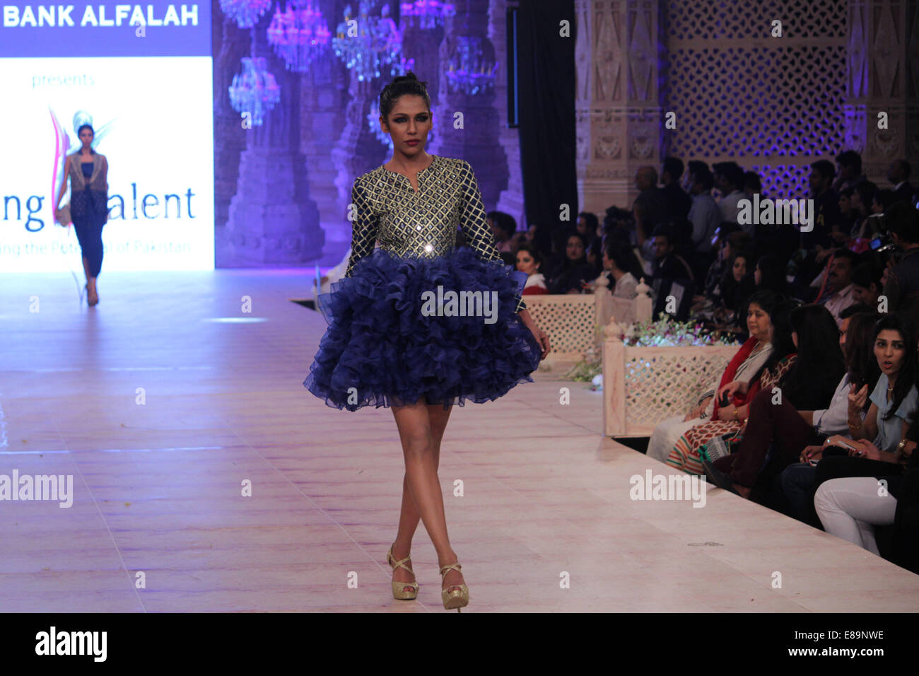 model ramp walk high resolution stock photography and images alamy https www alamy com stock photo lahore pakistan 1st october 2014 models walk on a ramp to present 73973466 html