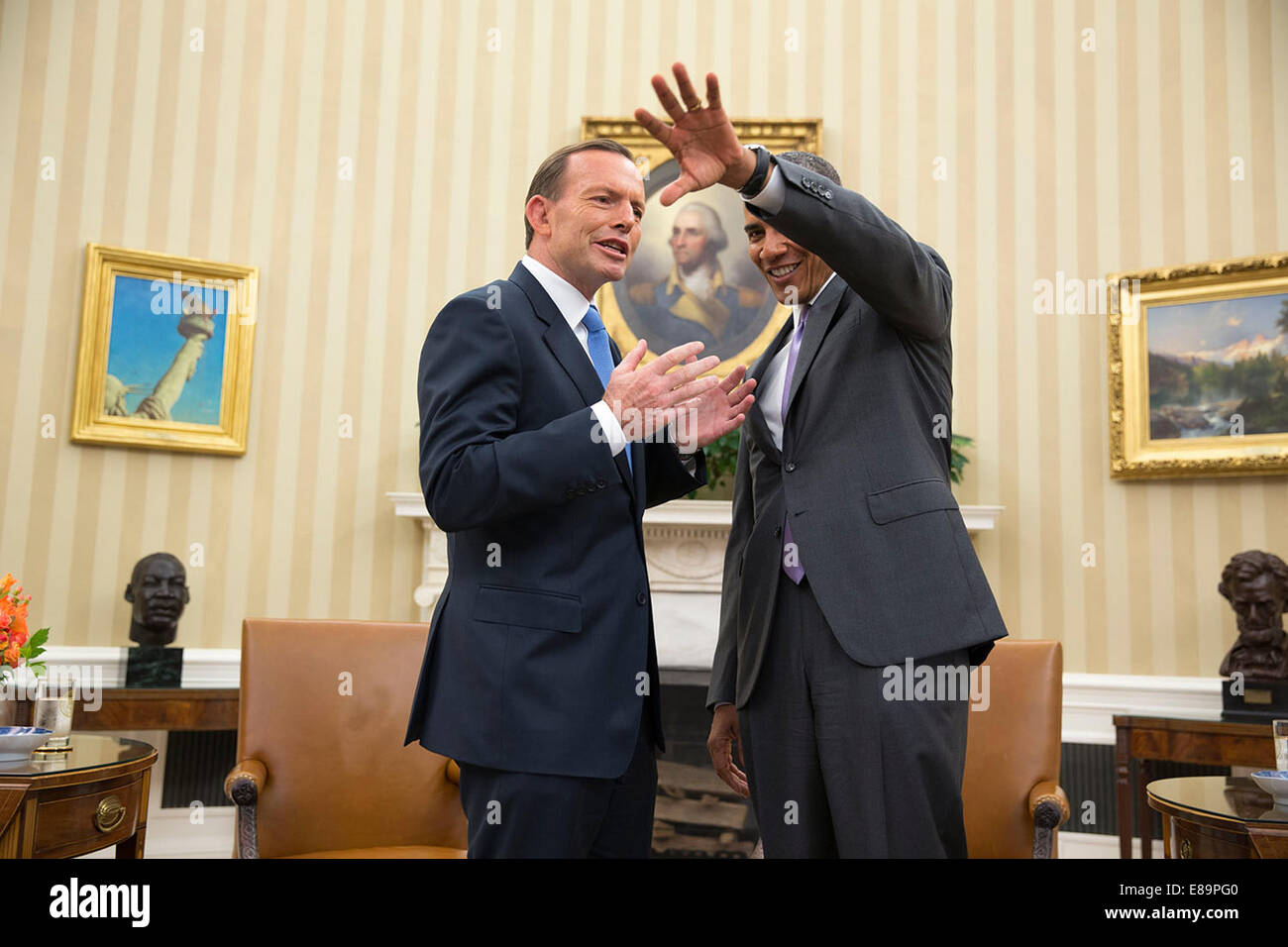 President Barack Obama jokes with Prime Minister Tony Abbott of Australia following a bilateral meeting in the Oval - Stock Image