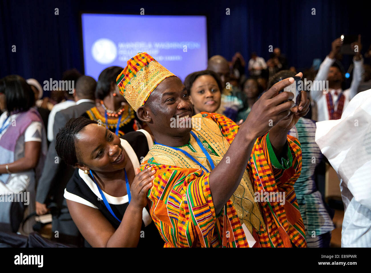Audience members take pictures of President Barack Obama as he shakes hands after a Young African Leaders Initiative - Stock Image